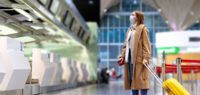 Woman in airport wearing mask experiencing new travel habits