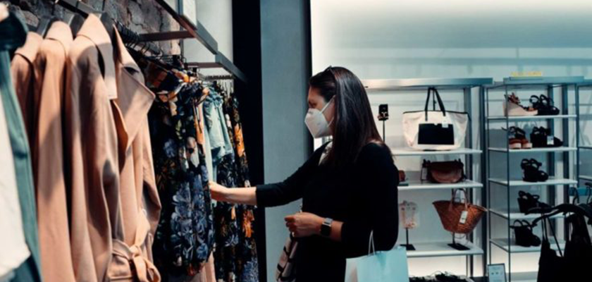 woman shopping for clothes during COVID-19 pandemic