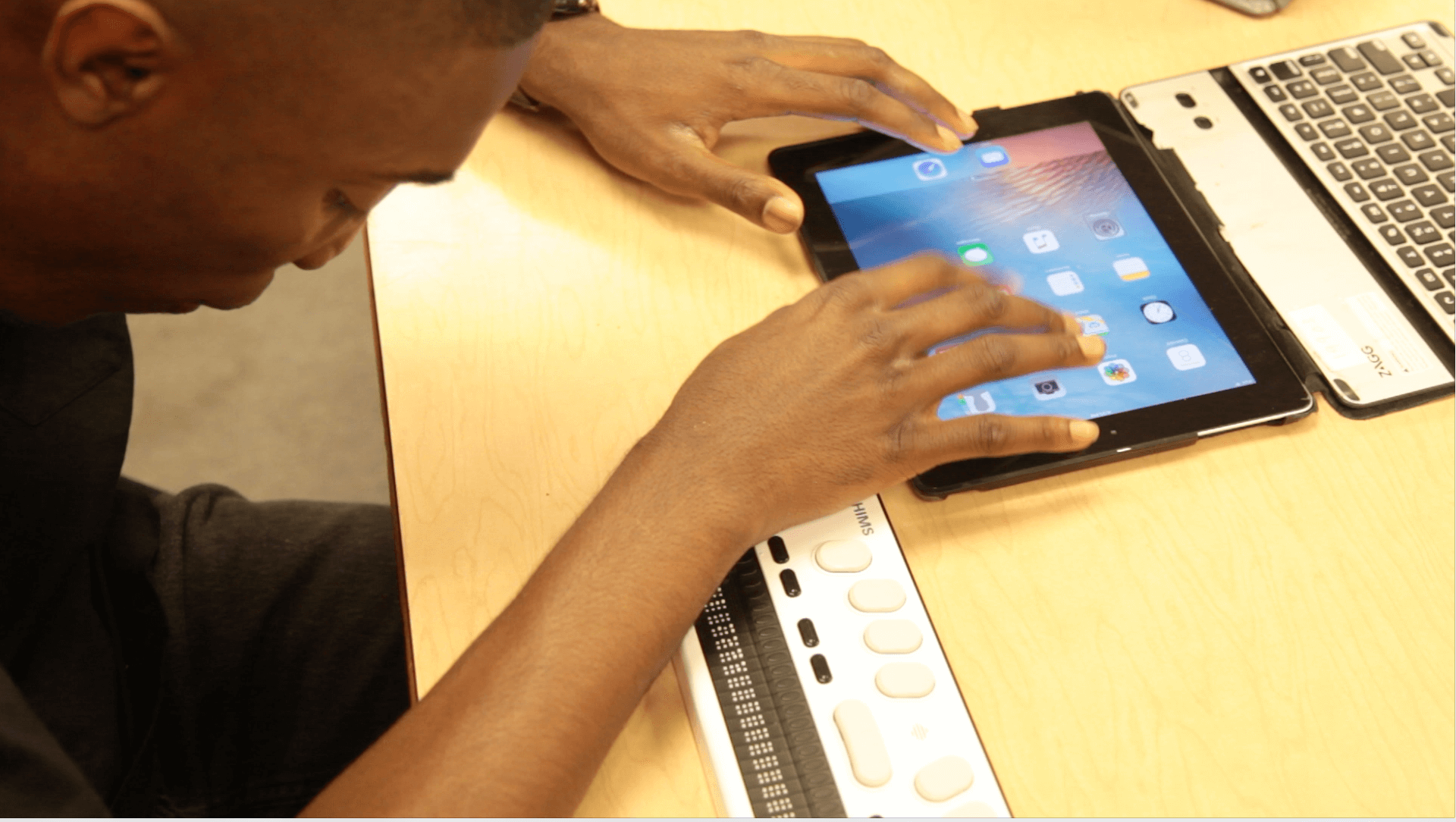 Student uses braille device at the Governor Morehead school in North Carolina