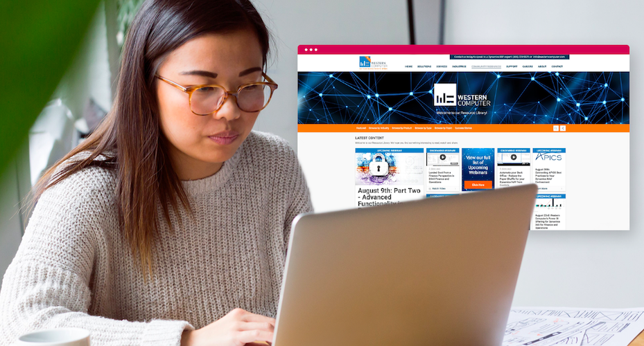 Woman looking at laptop with webpage screenshot next to her