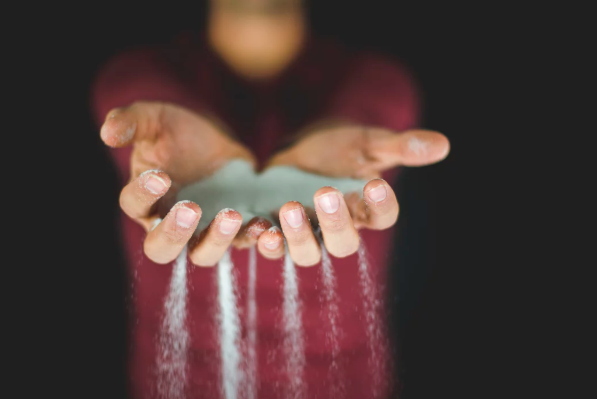 person with salt in hands