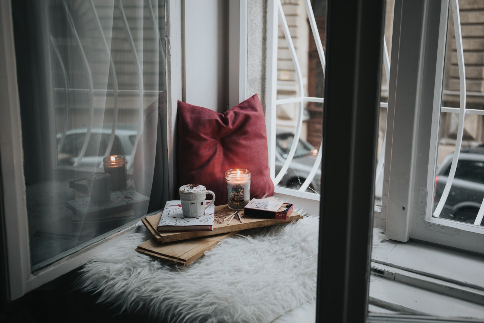 window sill with pillow book and candle
