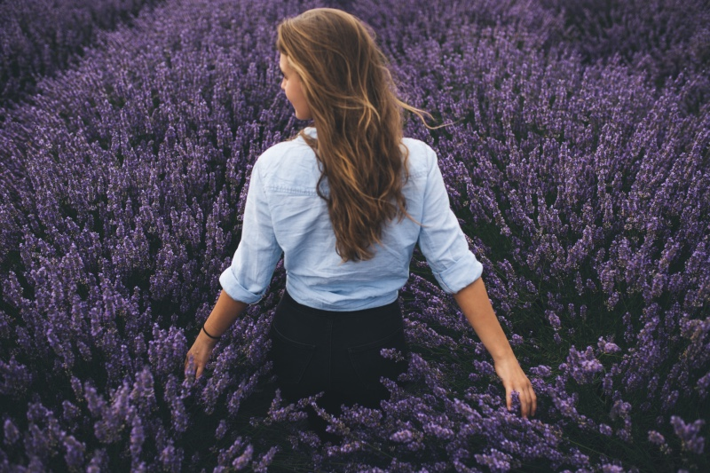woman standing in a field of lavender