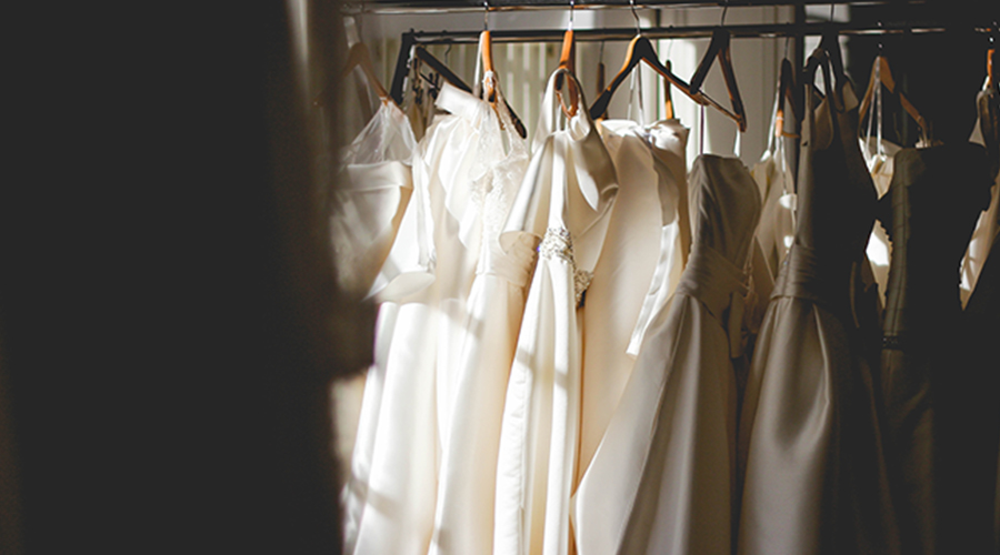 weddings gowns hanging on a rack