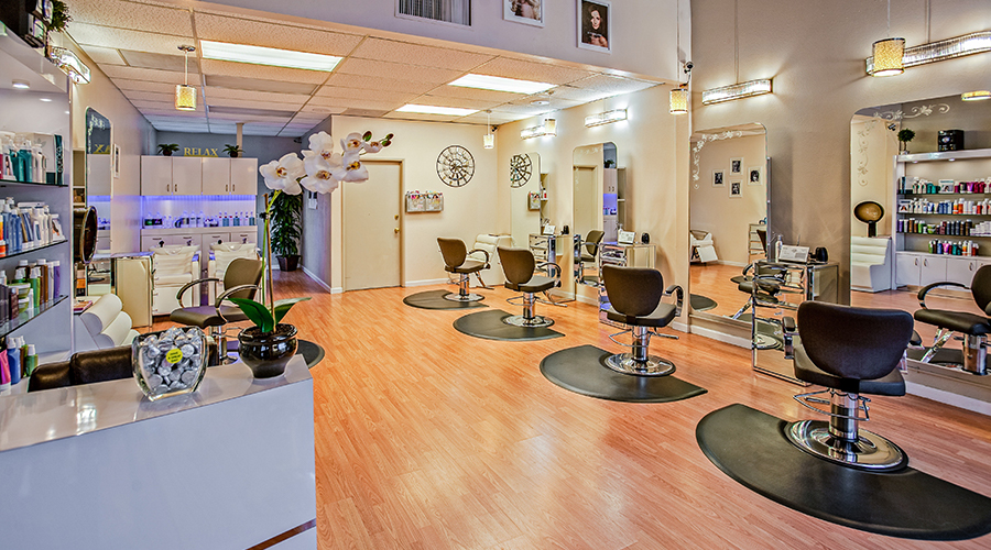 inside of salon with chairs and products