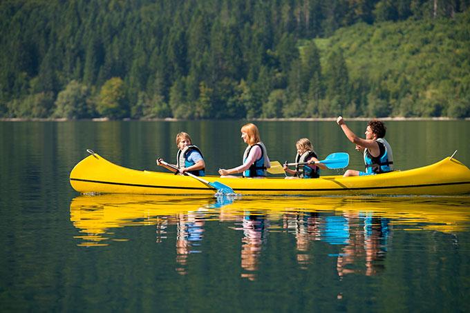 Photo of family in canoe on lake