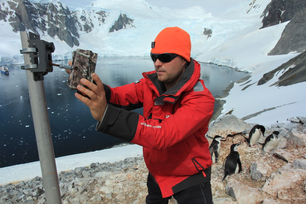 Penguinologist Tom Hart sets up a time lapse camera during a trip to Antarctica.