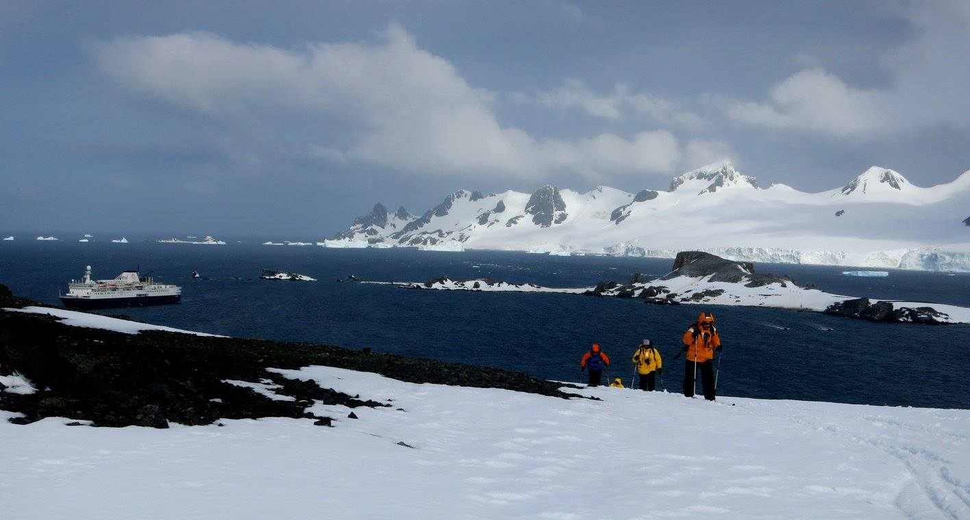 Cross-country skiing on the seventh continent; Ocean Endeavour awaits us below. Photo: Nick Mitchell