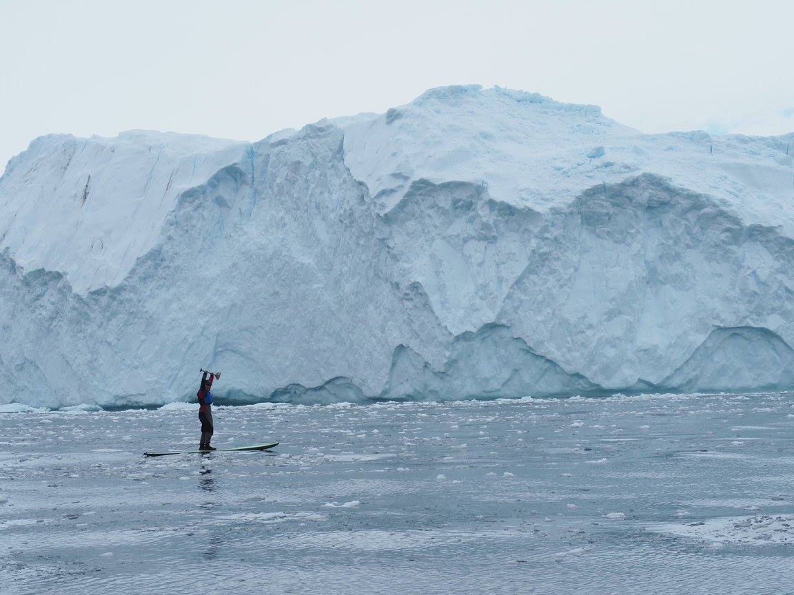 Stand-up paddleboarding the frigid waters off the Antarctic Peninsula. Photo: Nick Mitchell