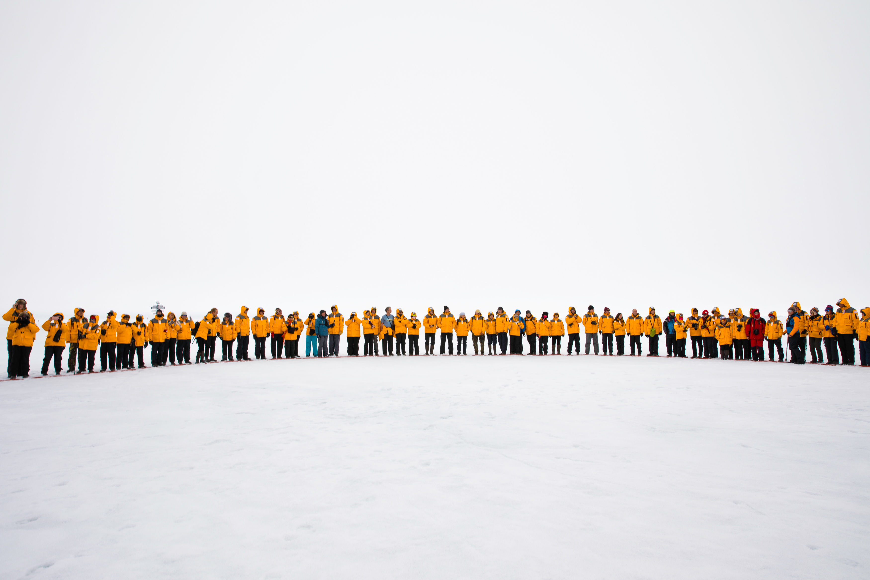 North Pole passengers standing together for the Circle Ceremony near the North Pole. Photo: Dani Plumb