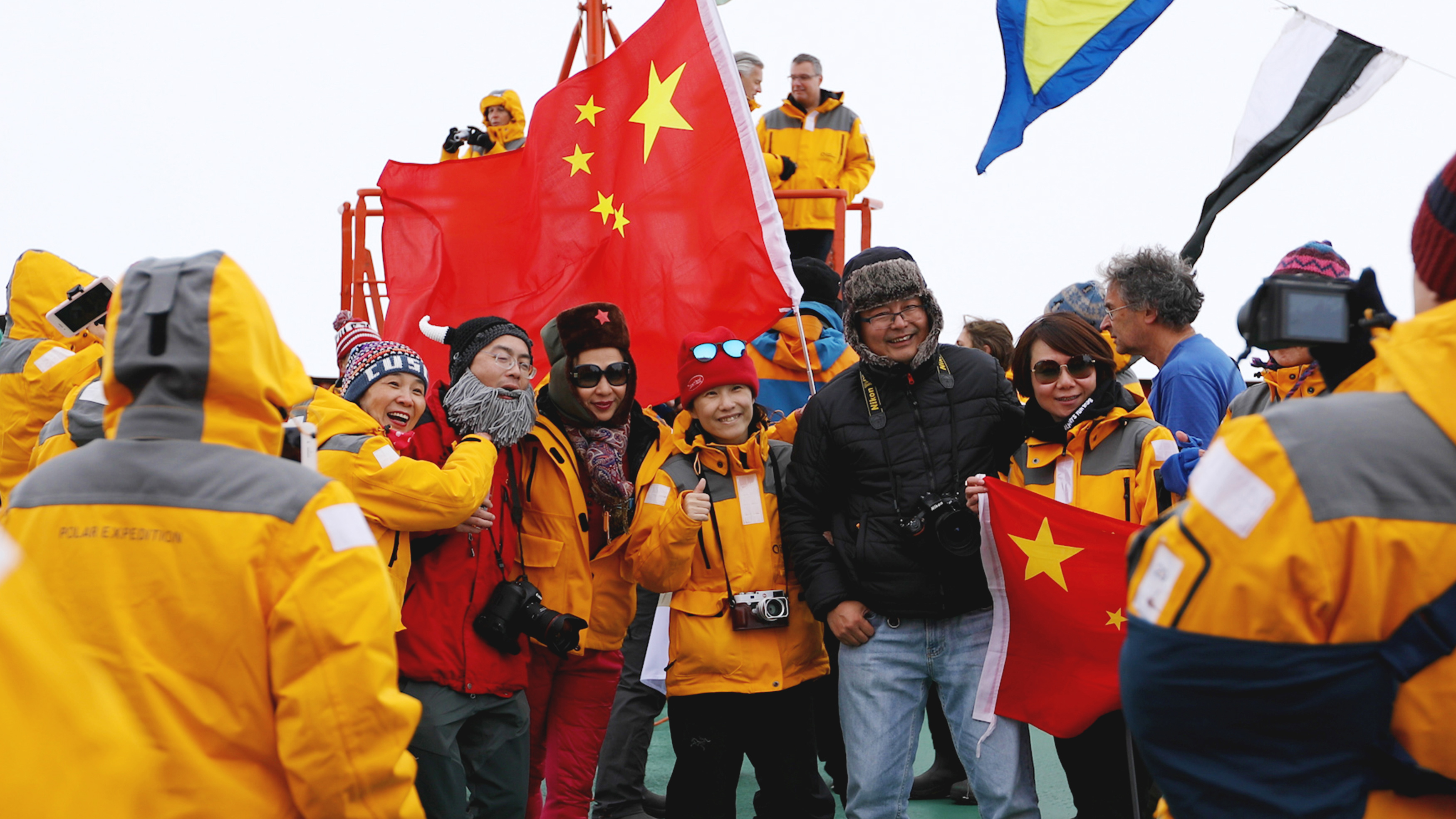A group of Chinese passengers celebrate reaching the North Pole. Photo: Dani Plumb