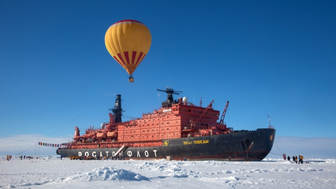 Soar high over the sea ice in a hot air balloon, one of the adventures available on a North Pole expedition.