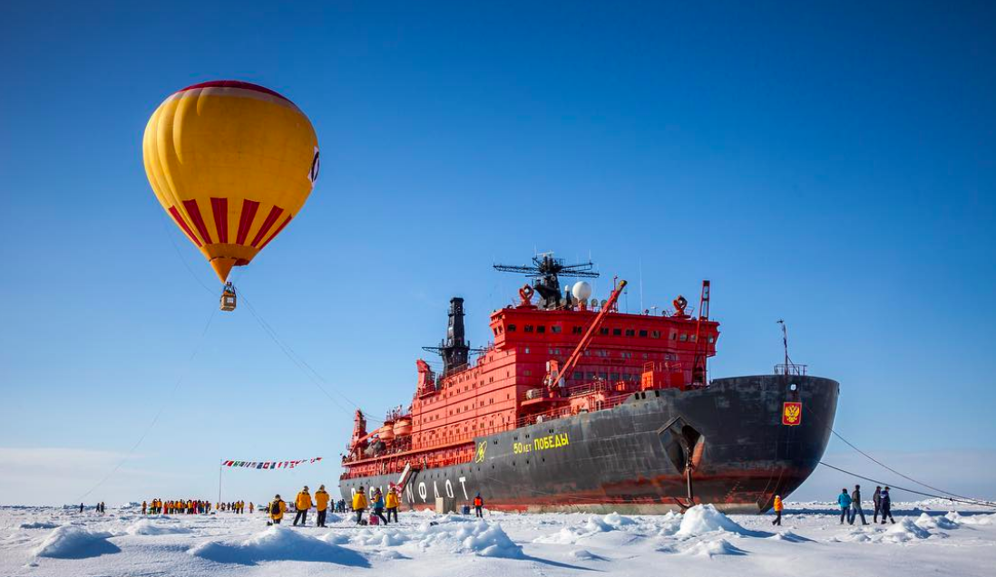 Passengers celebrate reaching 90 degrees North with an optional hot air balloon ride over the ice.
