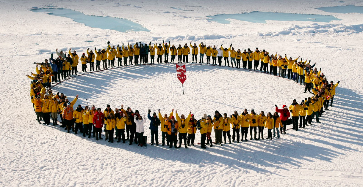 Passengers gather on the sea ice to celebrate the feat of reaching the North Pole.