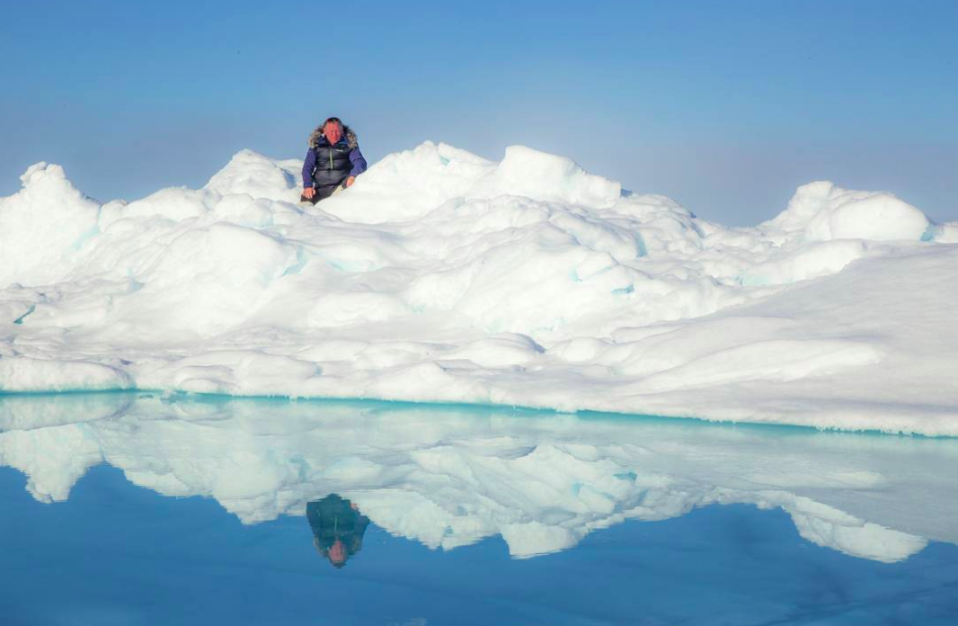Arctic explorer and motivational speaker Alan Chambers peers over the ice and melt at the North Pole. Photo credit: Tim Kohler
