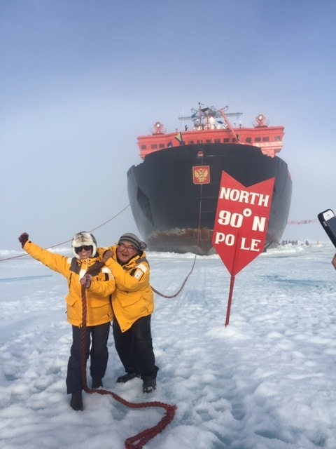 "David Serkoak and a fellow North Pole expedition passenger ""tow"" 50 Years of Victory across the ice at 90° North. Photo credit: David Serkoak"