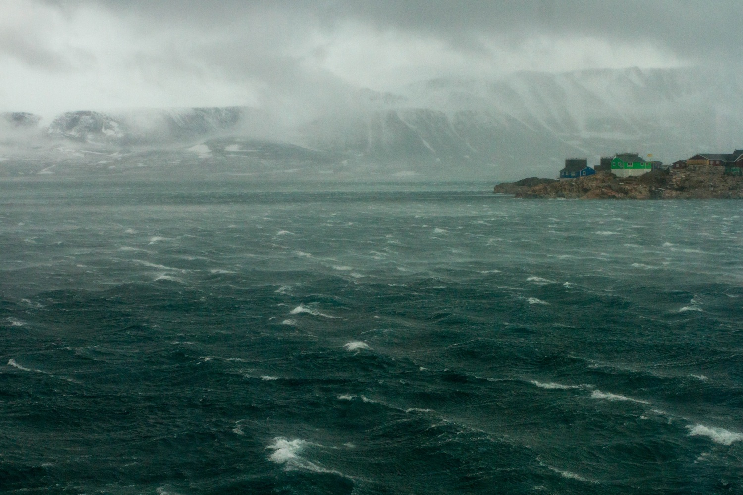 An Arctic storm rages over the Greenland village of Ittoqqortoormiit. Photo: Daven Hafey