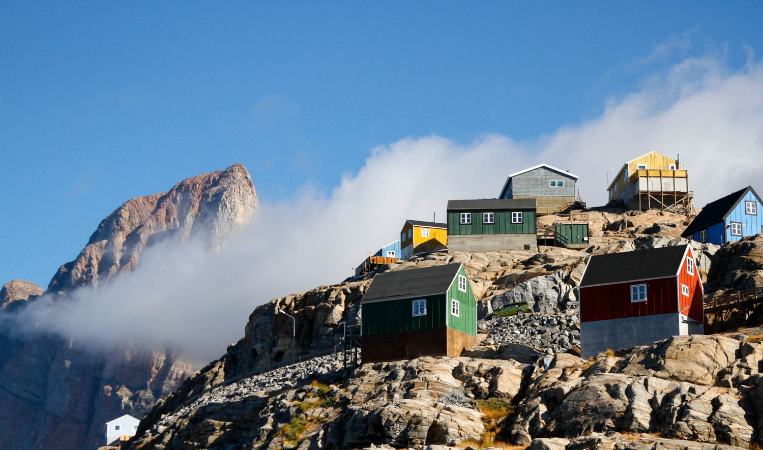 Traditional houses on a craggy rock hillside in the West Greenland village of Uummannaq. Photo: Daven Hafey