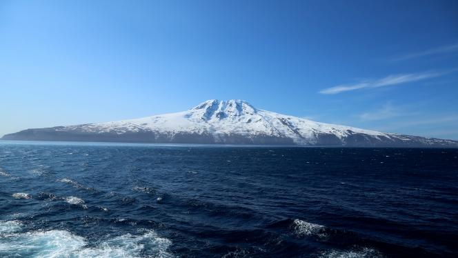 Mysterious, uninhabited Jan Mayen rises out of the deep, frigid blue of the Norwegian Sea.