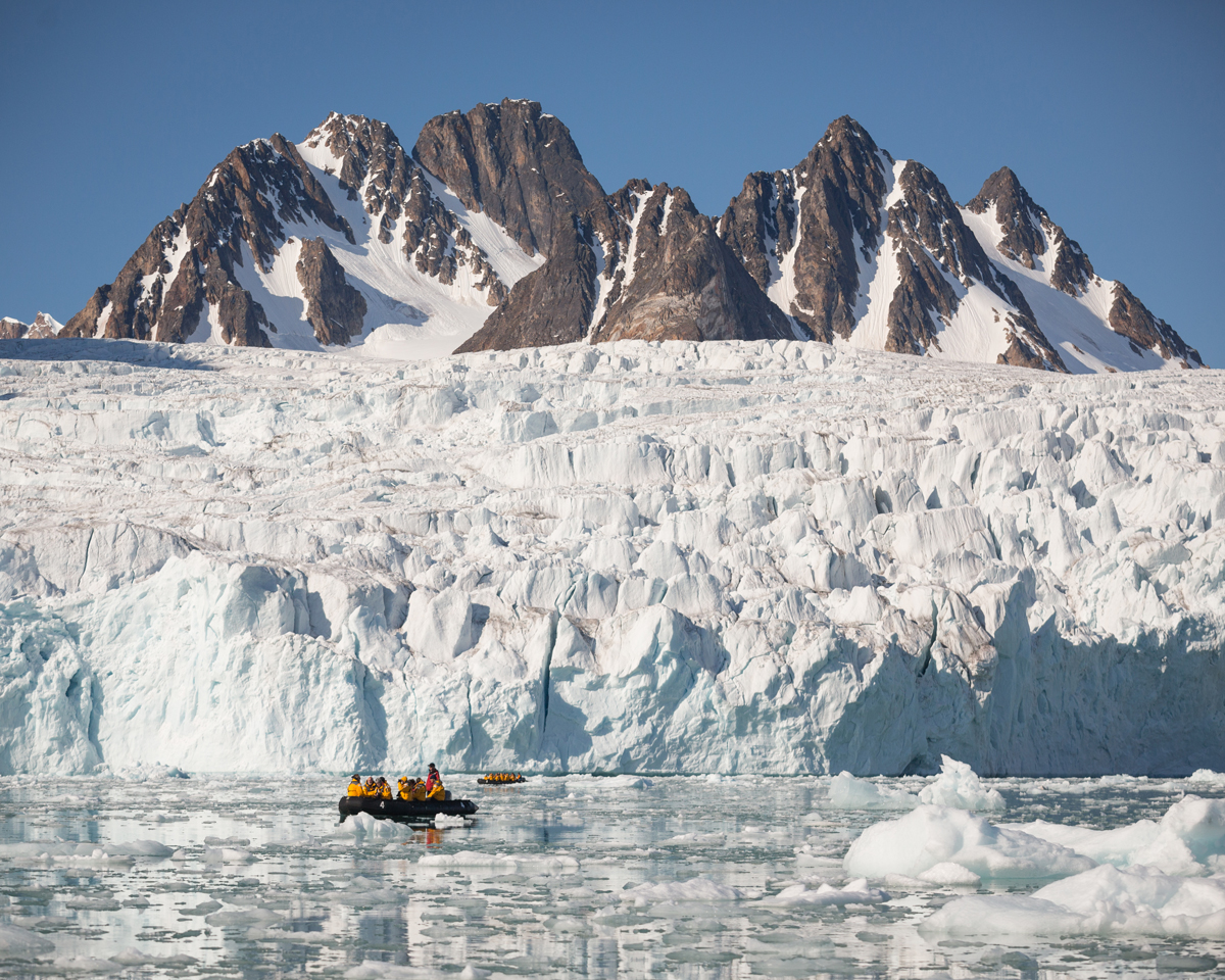 Quark passengers zodiac cruising in Spitsbergen.