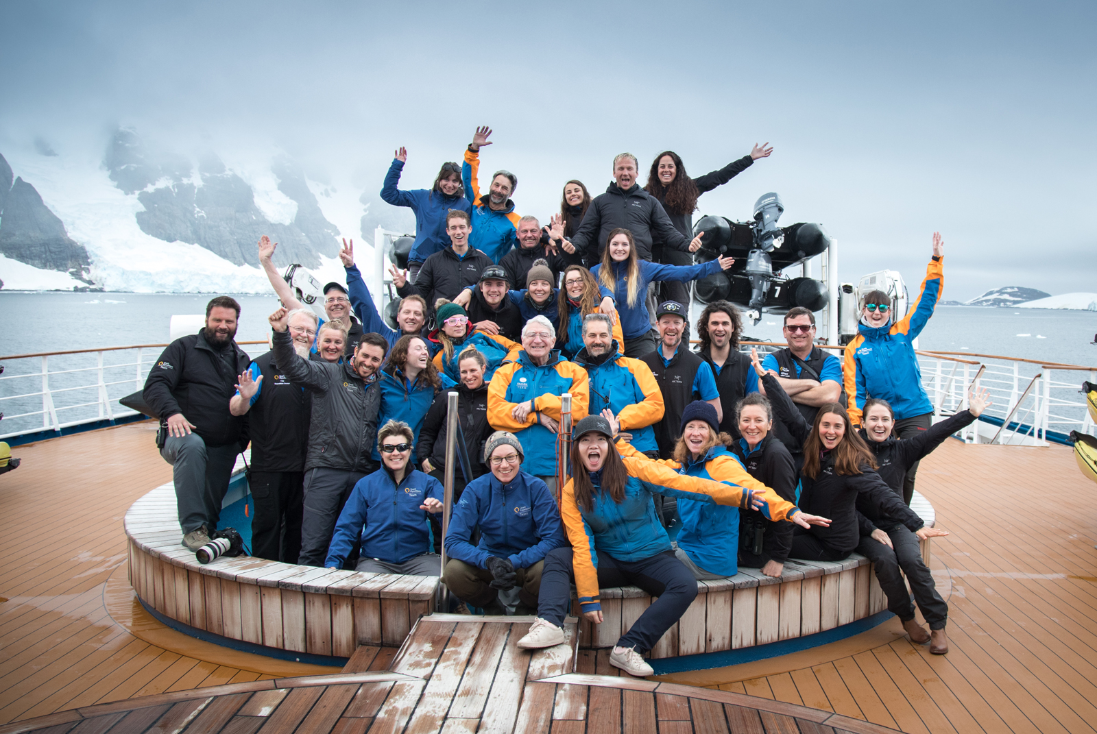 Expedition Team Members pose for a group photo on the Ocean Diamond