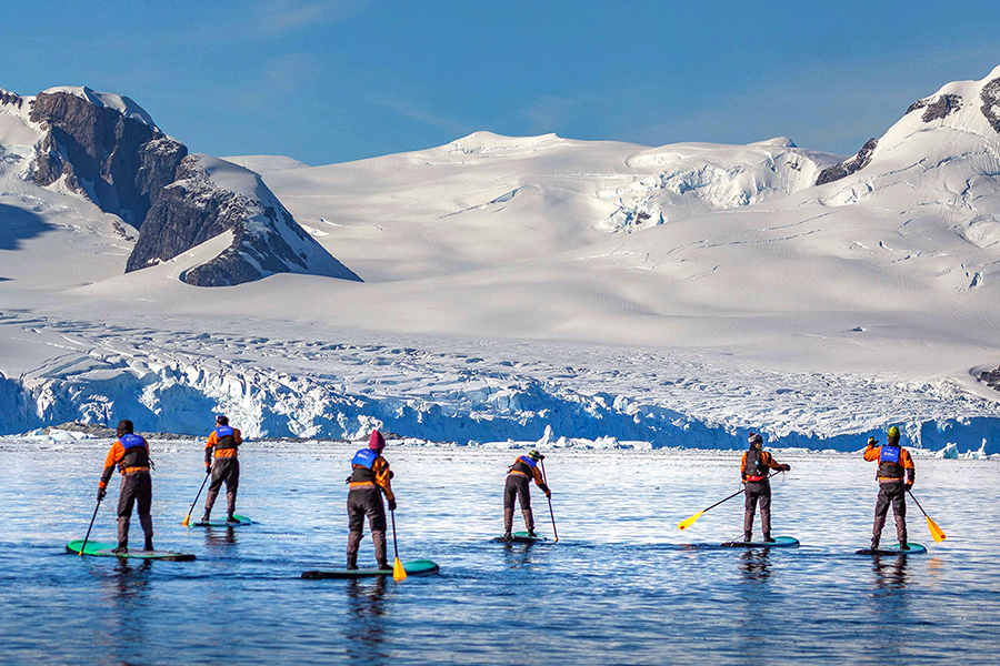 Stand-up Paddle Boarding in the Antarctic Peninsula. Photo: Abbey Weisbrot