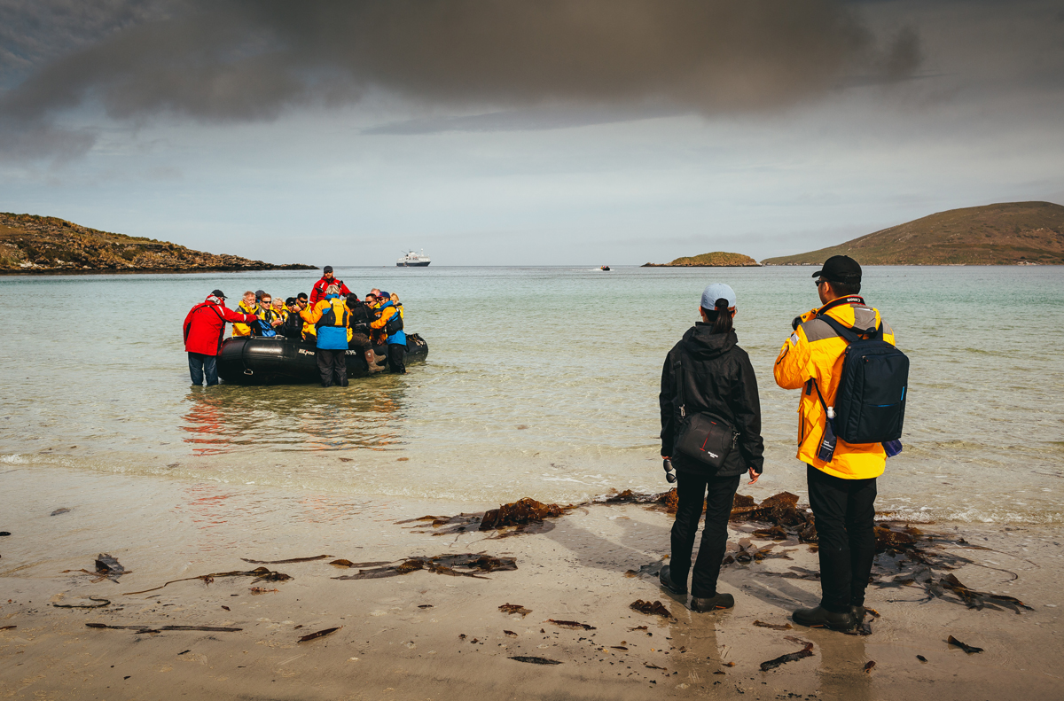 Passengers getting out of a zodiac at Saunders Island