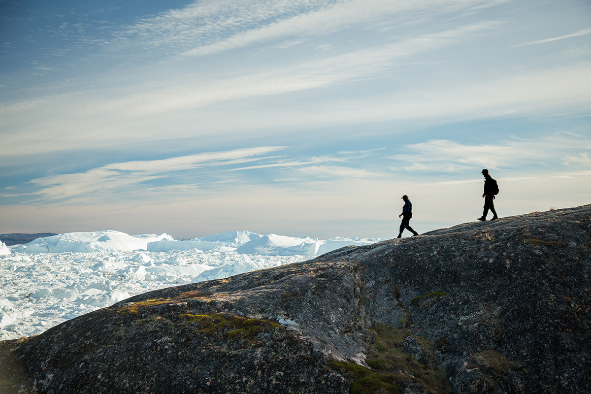 Passengers pictured hiking near Ilulissat Icefjord, in Greenland. Photo by Acacia Johnson