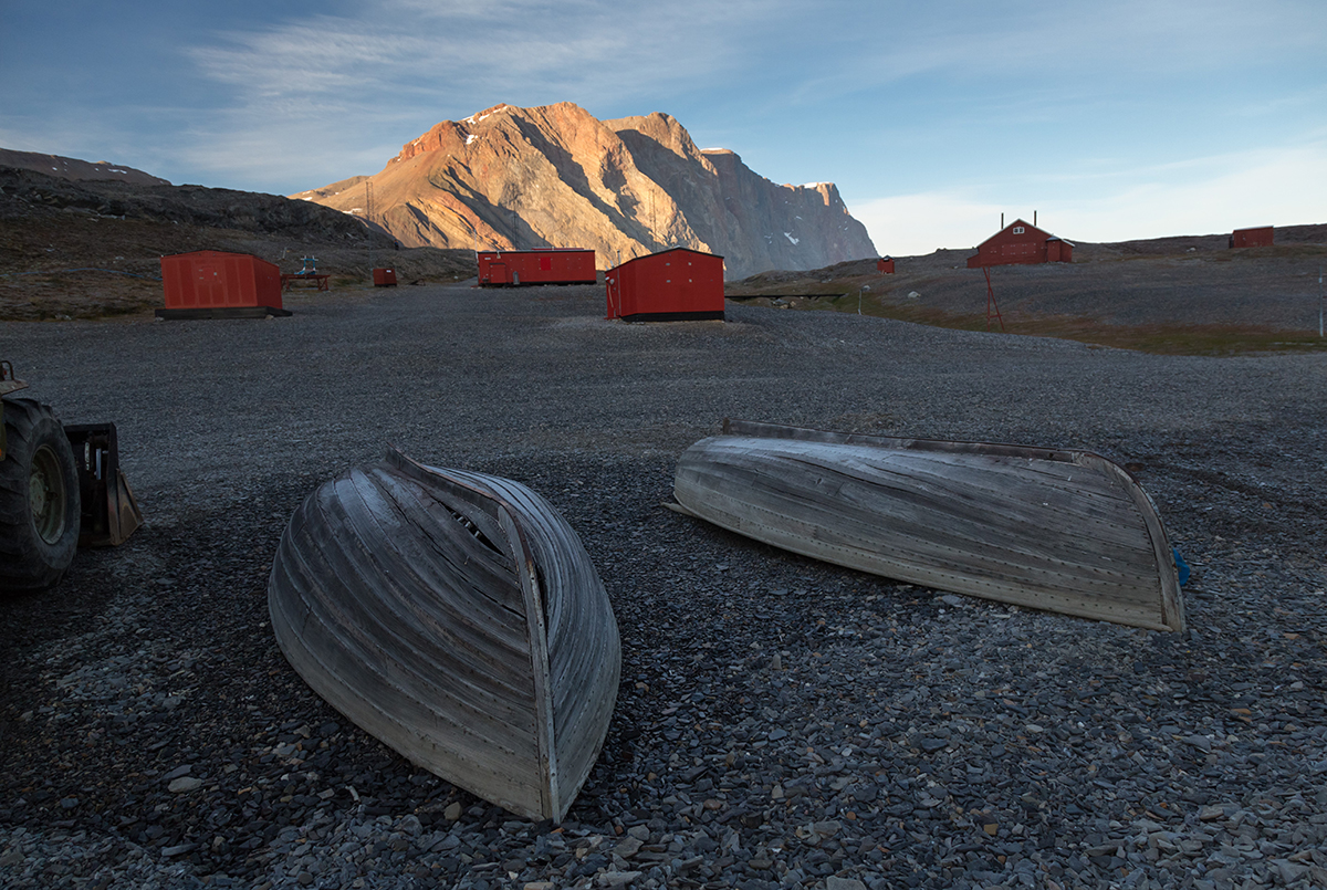 Old boats upside down at Ella Island, East Greenland. Photo by Acacia Johnson