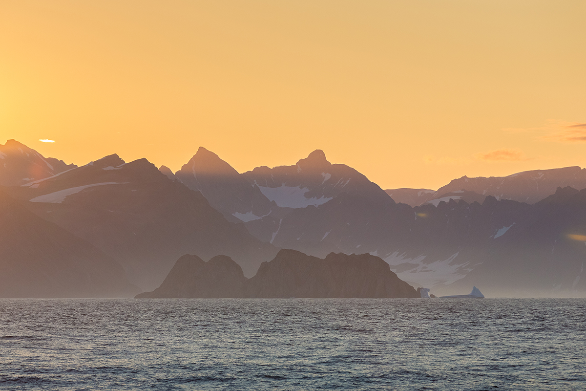 Sunset near the mouth of Scoresbysund, East Greenland.