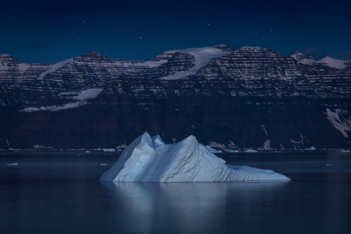 Long exposure photo of iceberg during evening hours in Greenland. Photo by Acacia Johnson