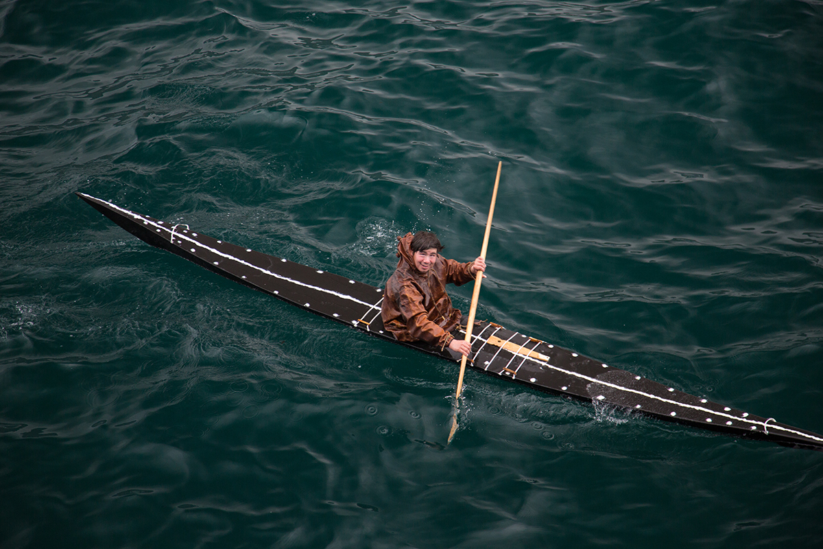 A Greenlandic kayaker, wearing a waterproof sealskin parka pictured in Ilulissat, West Greenland. Photo by Acacia Johnson