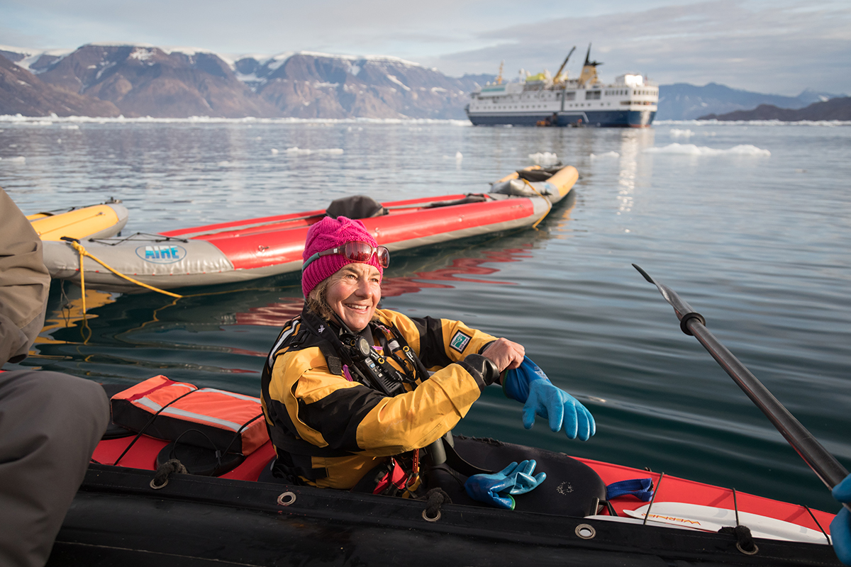 Quark Expeditions guide Jane Whitney prepares to lead the Paddle Excursion Program through a bay of glacier ice.Photo by Acacia Johnson