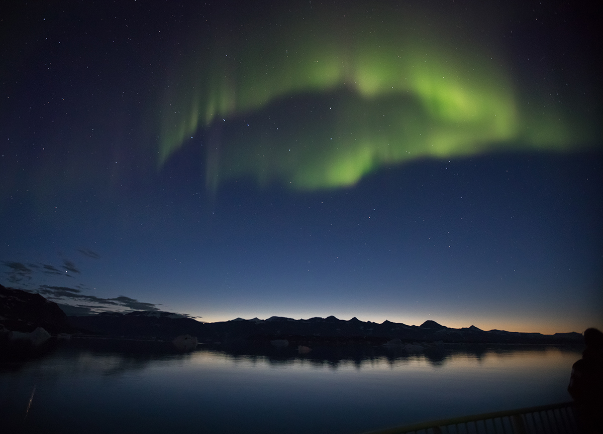 A brilliant arc of aurora near Danmark Island, East Greenland.Photo: Acacia Johnson