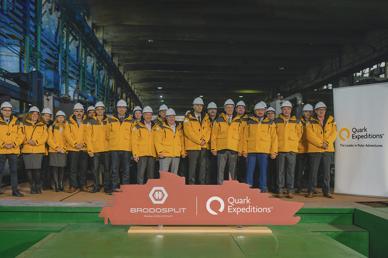 Quark Expeditions and Brodosplit team pose for a group photo at the Steel-Cutting Ceremony at the Shipyard.
