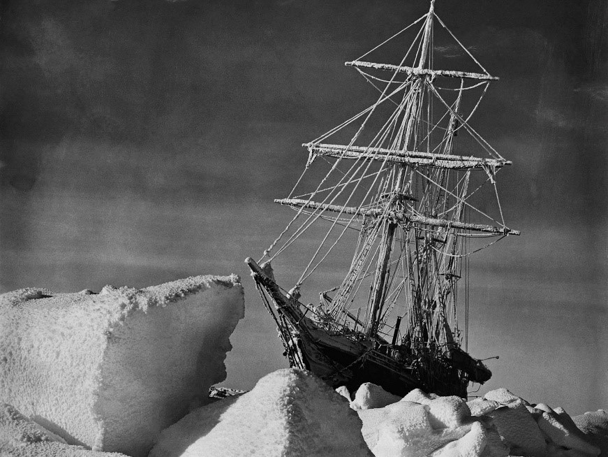 The ship, Nimrod behind ice floes.