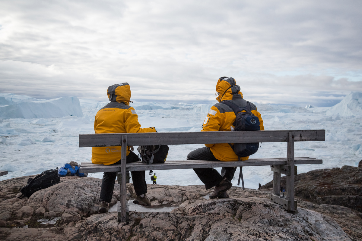 Quark Expeditions Passengers take a break while exploring the Ilulissat icefjord, in Greenland