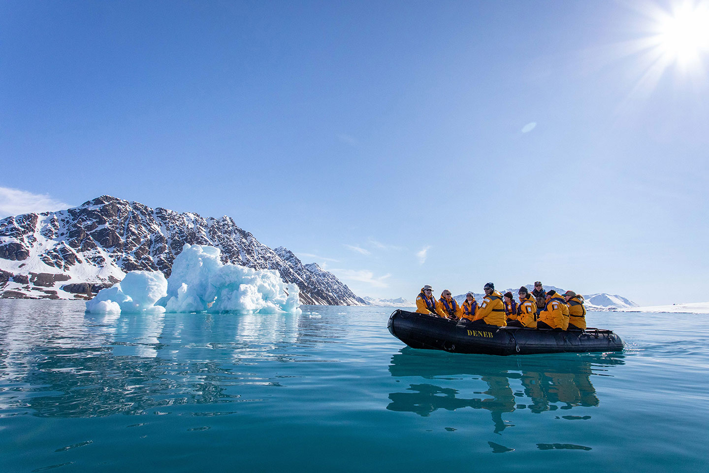 Guests enjoy a Zodiac tour during a polar expedition in Svalbard.