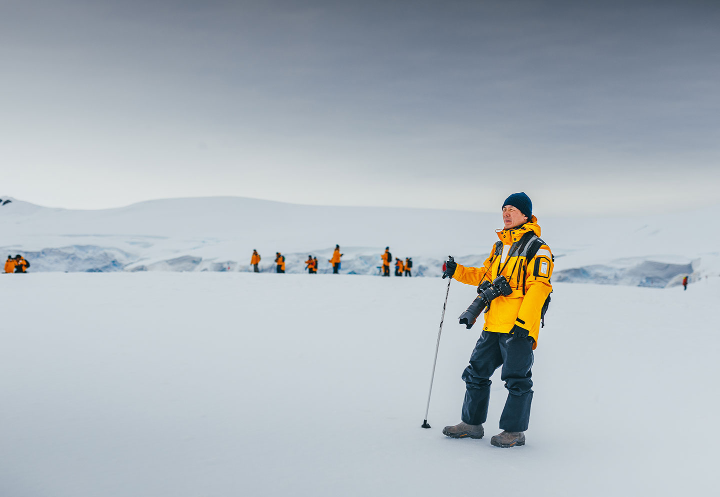 Guests traveling with Quark Expeditions enjoy some off-ship exploration while hiking in Antarctica.