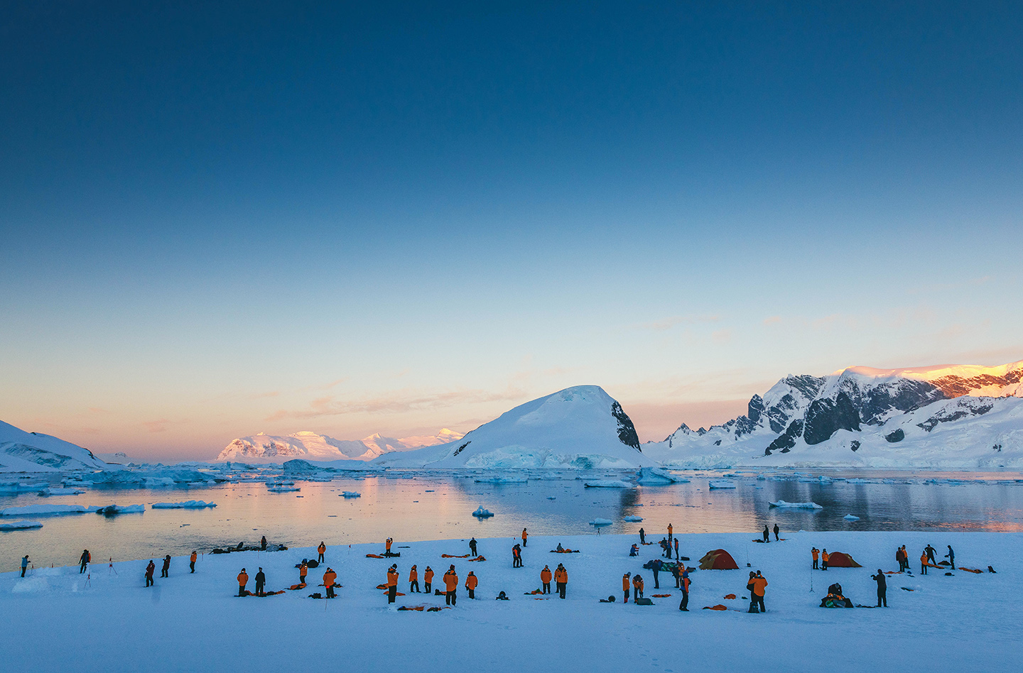 Quark Expeditions guests prepare for overnight camping in Antarctica.