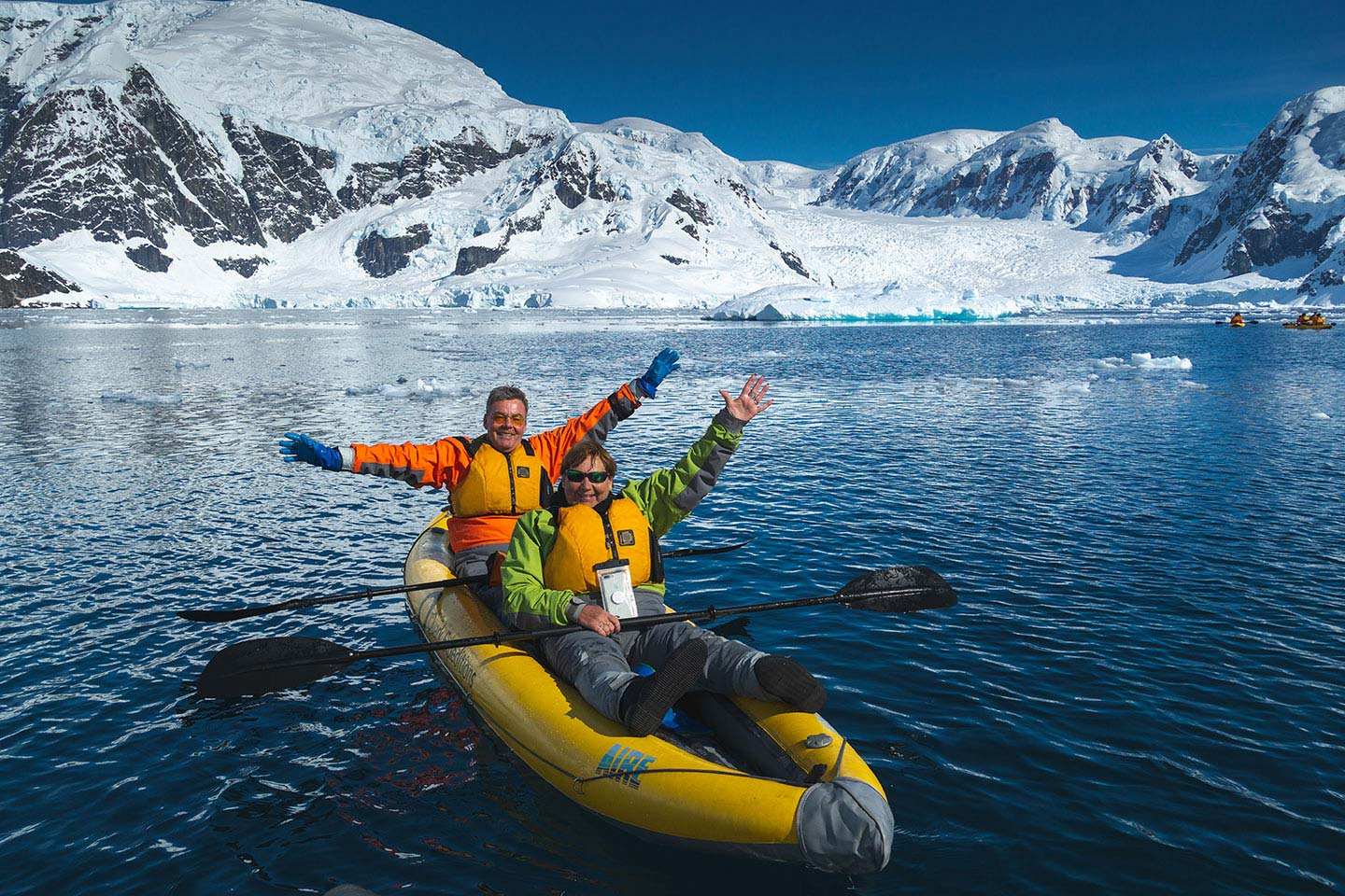 Quark Expeditions guests participate in the Sea Kayaking program during an Antarctic voyage.