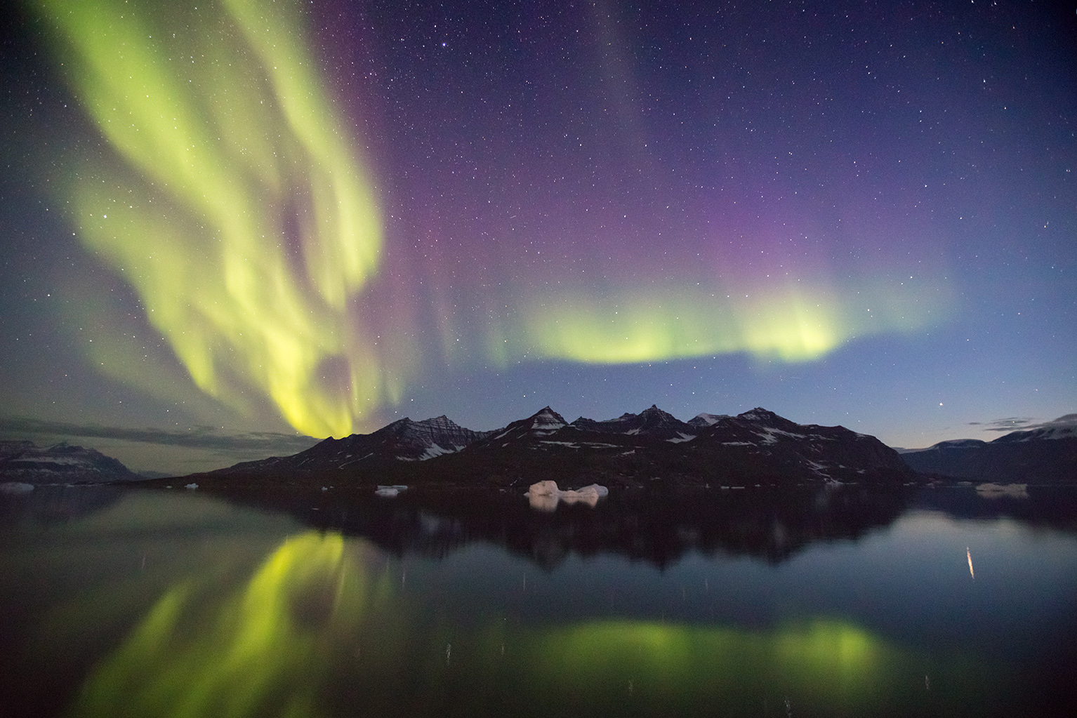 Remote regions in the Arctic, away from human-made light, are ideal locations to witness the Northern Lights