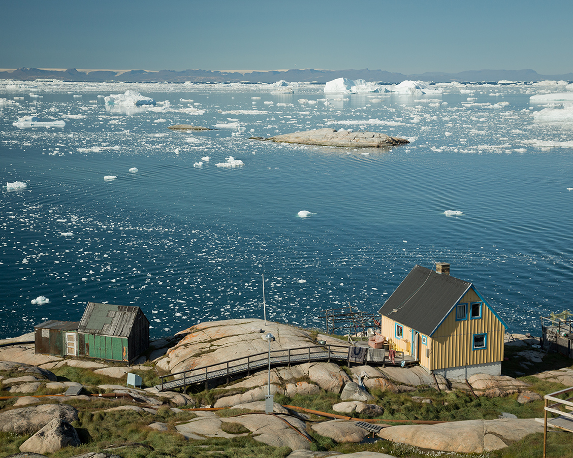 Guests traveling with Quark Expeditions enjoy visits to local communities in remote Greenland