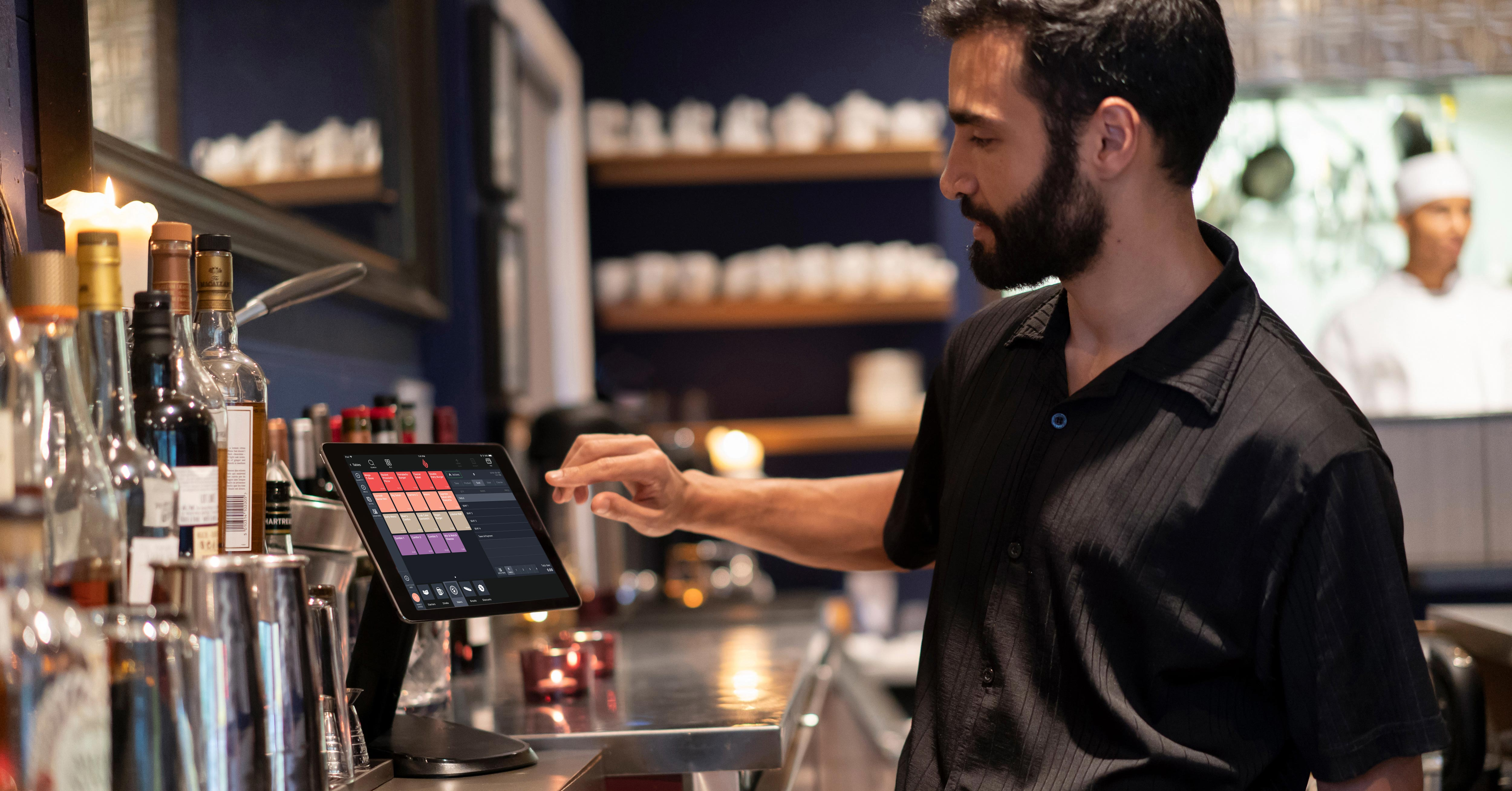 Restaurant owner entering order into an ipad pos solutions