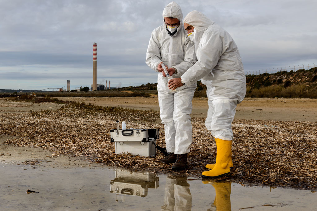 photo of two engineers managing waste samples