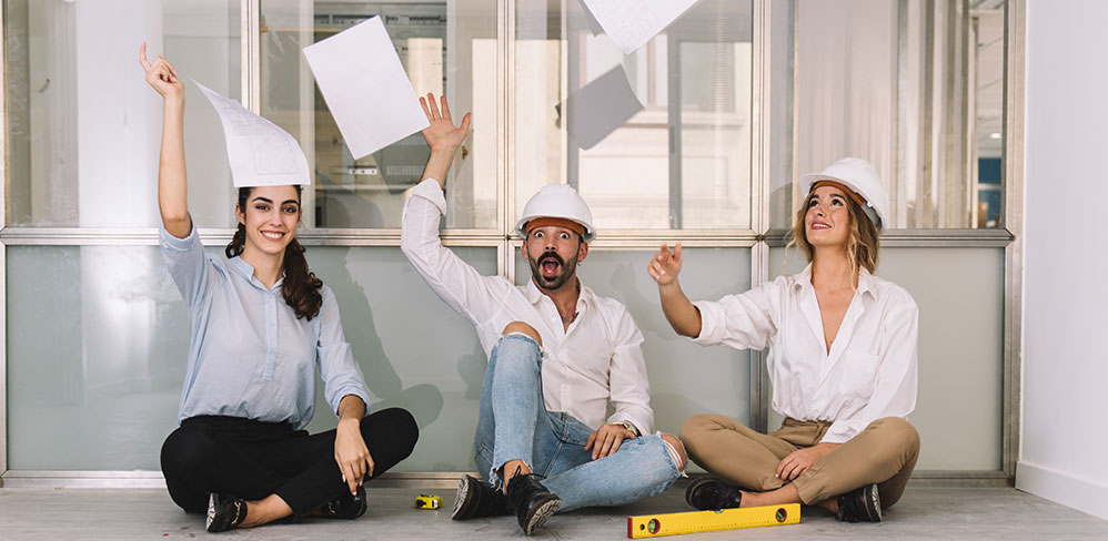 No more paper charts. Use software. Photo of 3 engineers throwing paper in the air