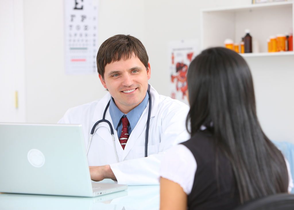 photo of doctor and patient using health clinic software