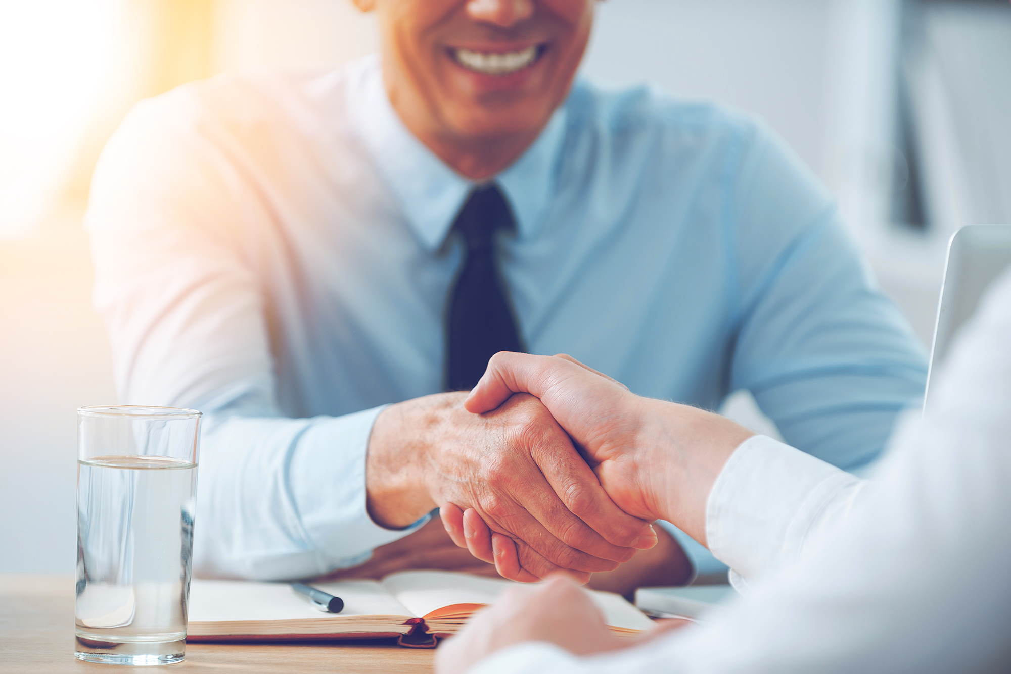 Candidate shaking hands with an interviewer after a structural interview