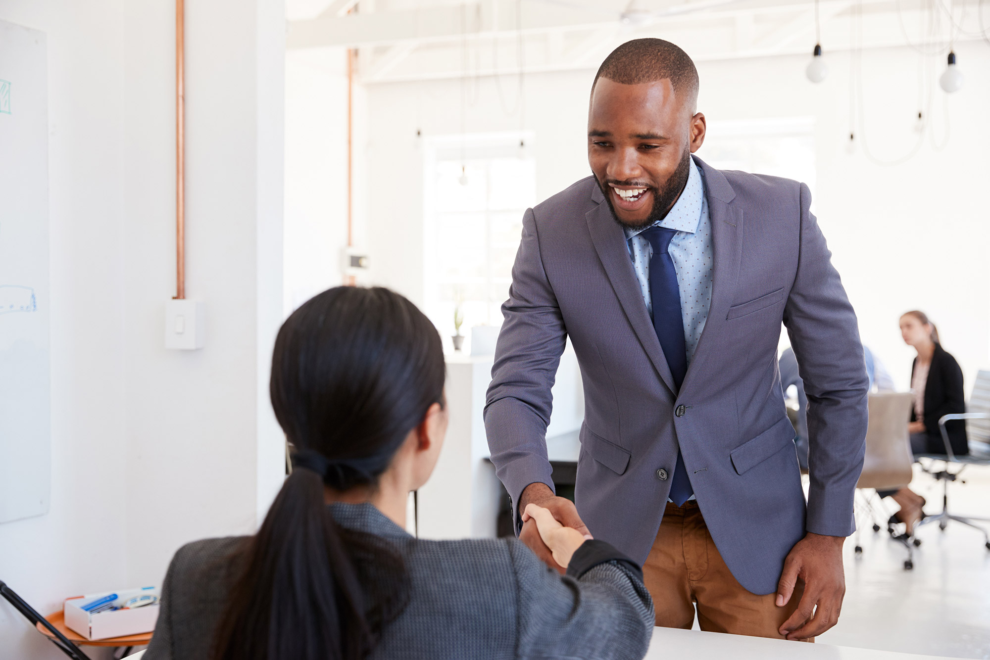 interviewer shaking hands with a job candidate