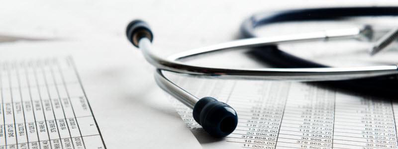 PEO businessman explaining medical plan report